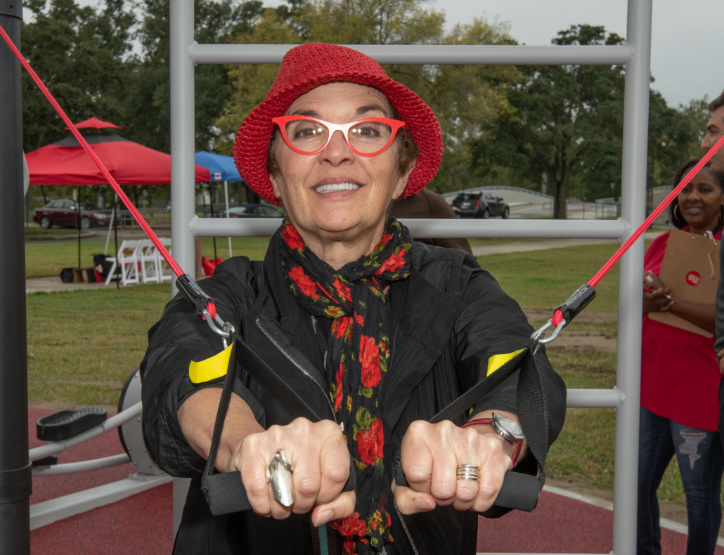 Local resident trying out the bands at the Fitlot Outdoor Fitness Park at Joe W. Brown Park in New Orleans, Louisiana