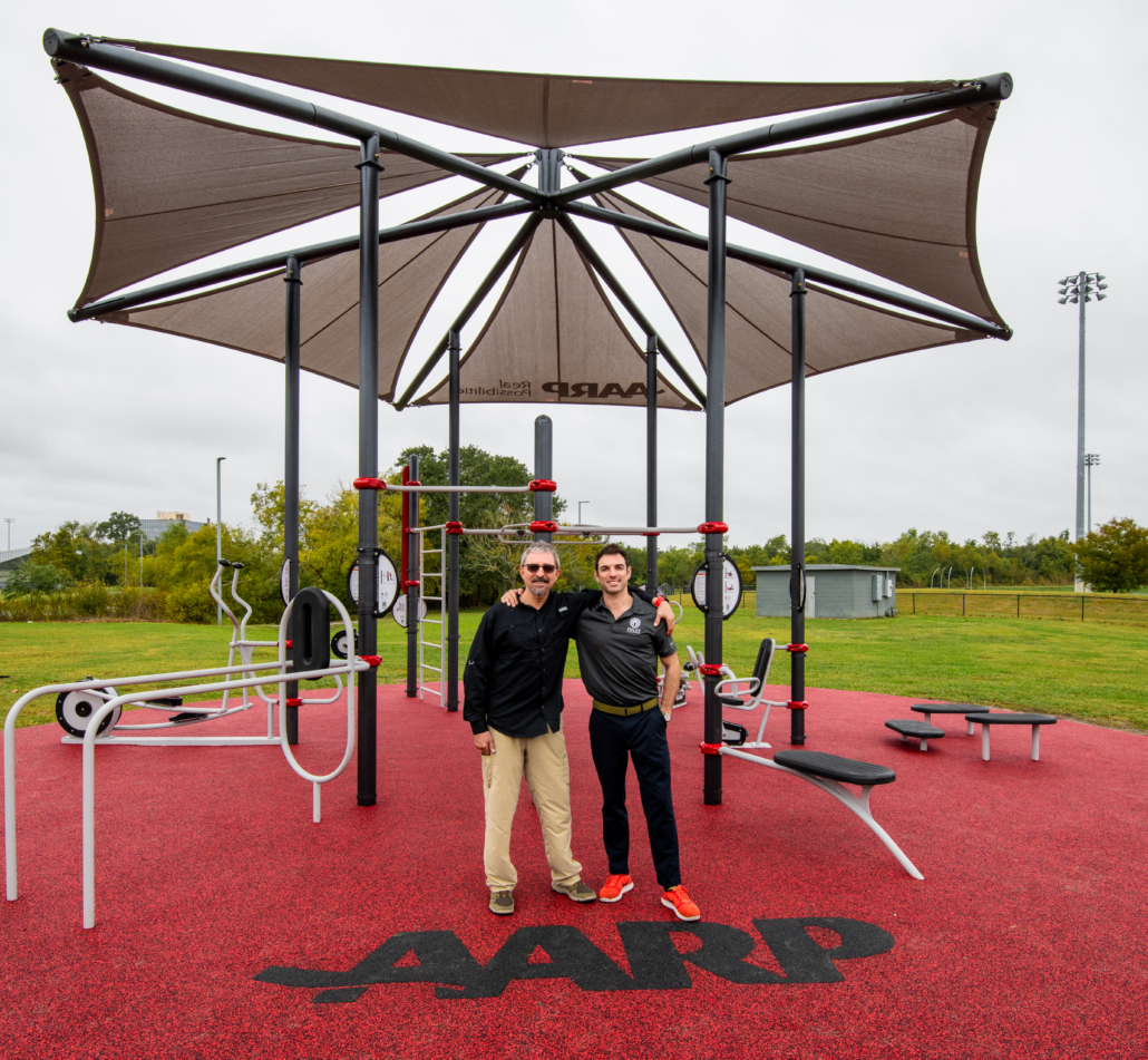 Father and son pose at the new Fitlot Outdoor Fitness Park at Joe W. Brown Park in New Orleans, Louisiana