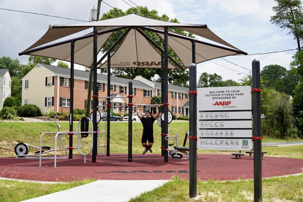 People working out at the FitLot Outdoor Fitness Park in Winston-Salem, NC