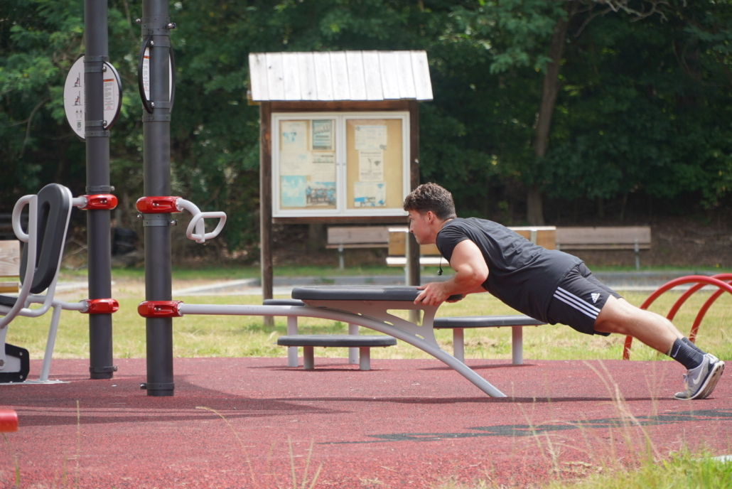 Person exercising at FitLot Outdoor Fitness Park in Winston-Salem, NC