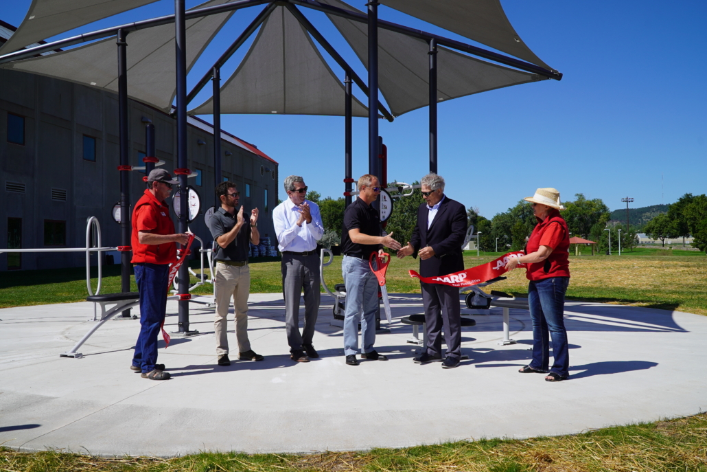 officials cutting the ribbon at the FitLot Outdoor Fitness Park in Rapid City, South Dakota