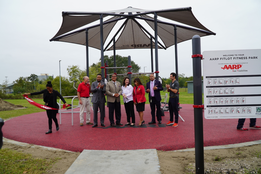 Officials cutting the ribbon at the Fitlot Outdoor Fitness Park at Joe W. Brown Park in New Orleans, Louisiana