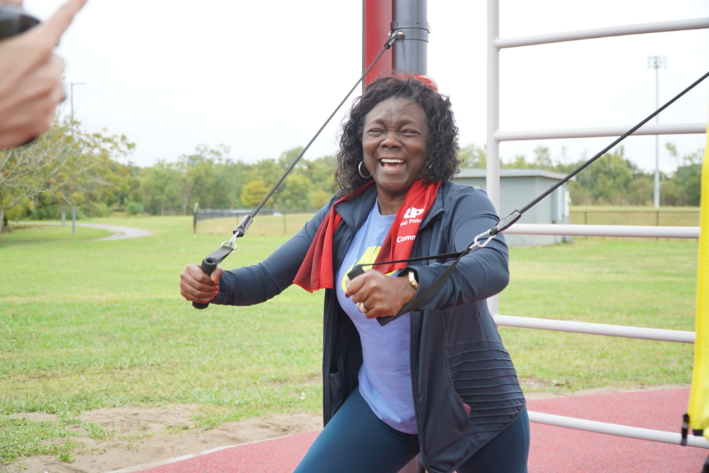 Local resident trying out the equipment at the Fitlot Outdoor Fitness Park at Joe W. Brown Park in New Orleans, Louisiana